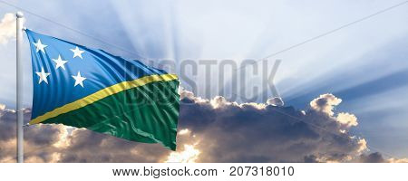 Solomon Islands waving flag on blue sky. 3d illustration