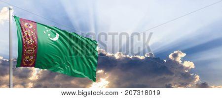 Turkmenistan waving flag on blue sky. 3d illustration