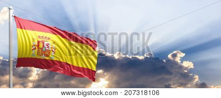 Spain waving flag on blue sky. 3d illustration