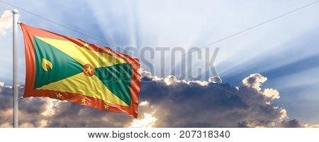 Grenada waving flag on blue sky. 3d illustration