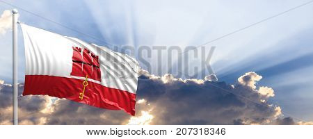 Gibraltar waving flag on blue sky. 3d illustration
