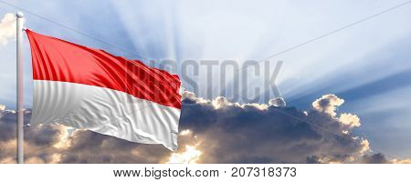 Indonesia waving flag on blue sky. 3d illustration