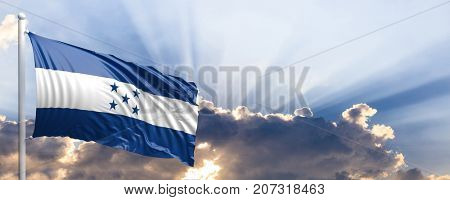 Honduras waving flag on blue sky. 3d illustration