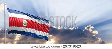 Costa Rica waving flag on blue sky. 3d illustration