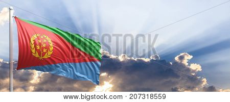 Eritrea waving flag on blue sky. 3d illustration