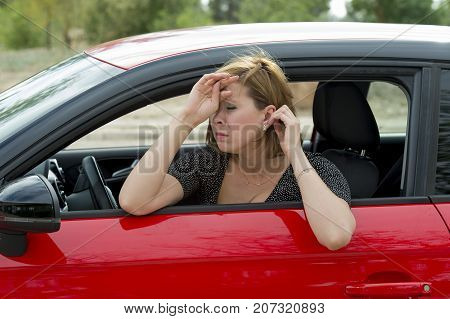 female rookie new driver young beautiful woman scared and stressed while driving car in fear and shock face expression in stress and confusion