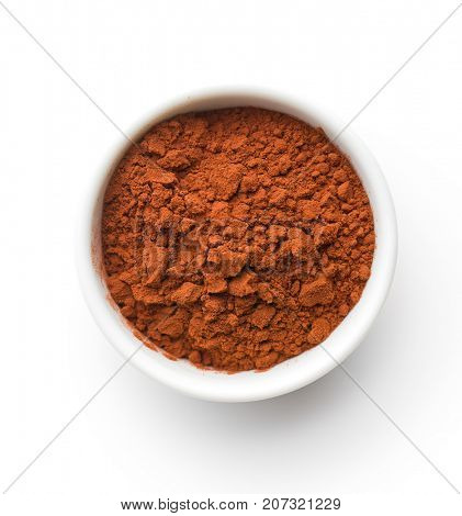 Tasty cocoa powder in bowl isolated on white background.