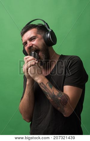 Singer With Beard And Interested Face Enjoys Music.