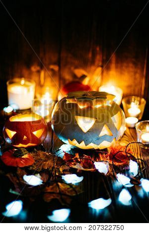 Halloween decorations. Spooky jack-o-lanterns burning in darkness