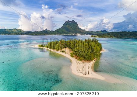Bora Bora aerial view of luxury travel cruise ship vacation destination. Drone shot above motu paradise island r in lagoon and Mt Pahia, Mount Otemanu, Tahiti, French Polynesia, South Pacific Ocean.
