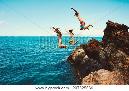 Cliff jumping into the ocean, summer fun adventure lifestyle