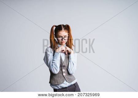 girl secretary clasps hands with hurt face