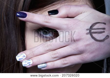 Young Serious Woman Looking Through Fingers And Hand Drawn With Money As A Symbol Of Bribery Cheatin