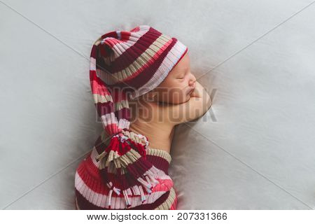 indoor portrait of newborn baby wrapped, newborn photography, sleeping child