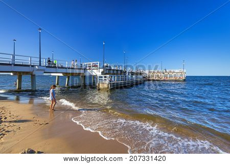 GDANSK, POLAND - AUGUST 14, 2017: People on the sunny beach of Baltic Sea in Gdansk Brzezno. Gdansk is very popular tourist destination for summer holidays at Baltic Sea in Poland.