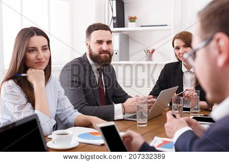 Successful team with female boss. Office discussion, analysis, planning, communication with partners at the desk