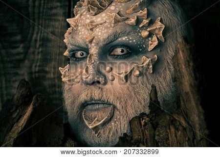 Man With Dragon Skin And Bearded Face