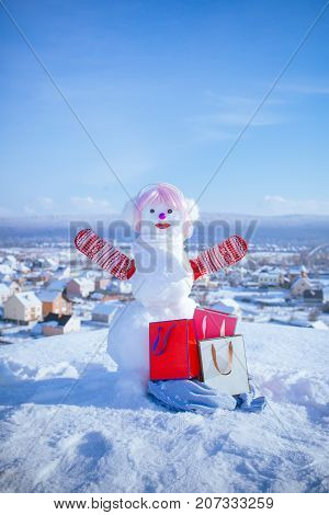 New Year Snowman From White Snow With Shopping Bag.