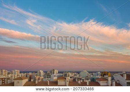 Buildings and ocean horizon in Armacao de Pera, Algarve, Portugal, at twilight