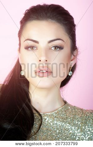 Woman With Brunette Hair On Pink Background