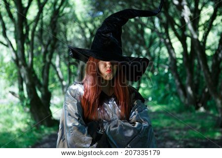 Image of dissatisfied witch in long black hat