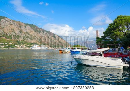 KOTOR MONTENEGRO - SEPTEMBER 10 2017: Cruise ship and boats near Kotor embankment. Beautiful view of Bay of Kotor Montenegro