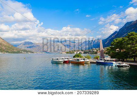 KOTOR MONTENEGRO - SEPTEMBER 10 2017: Beautiful view of Bay of Kotor. Obelisk of Freedom on waterfront in Freedom Park Kotor Montenegro