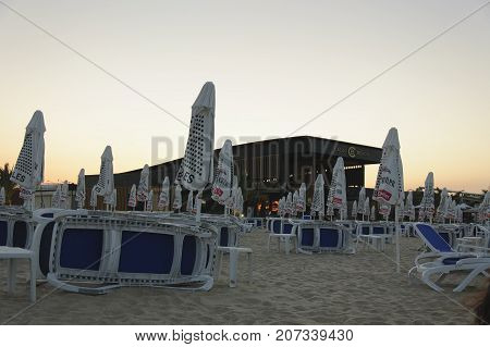 Sunny Beach Bulgaria - 22 Juny 2016: Chaise lounges and parasols near night club