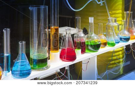 glassware with colorful liquids  in sunny day