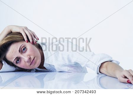 I want to sleep I don't want to work today. Young business woman tired from office work with documents. (Body language gestures psychology concept)