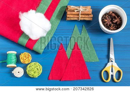 Making Christmas tree sachet with aromatic spices your own hands. Christmas present. Original art project. DIY concept. Step by step photo instructions. Step 2. Cutting out triangles for spruces