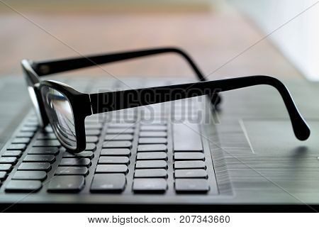 Glasses on the computer keyboard during a break