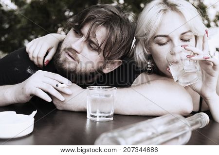 Couple smoking and drinking alcohol. Drunk young people (alcoholism in family pain pity hopelessness social problem of dependence depression concept)