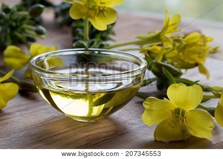 Evening Primrose Oil In A Glass Bowl On A Wooden Table