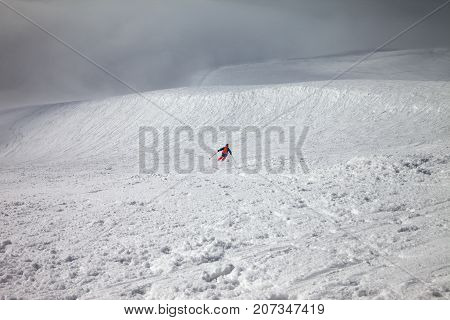 Skier Downhill On Freeride Slope And Overcast Misty Sky Before Blizzard