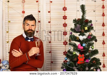 Party Man With Confused Face In Festive Room.