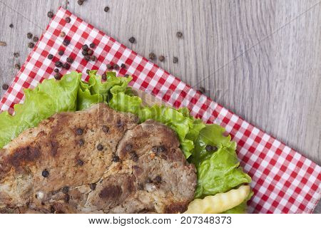 Tasty Pork Roast On The Grill With  Fresh Lettuce And Pepper