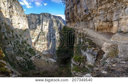 The impressive Vikos gorge in the Zagoria region, Western Greece, the deepest in Europe, with some ruins of a monk house.
