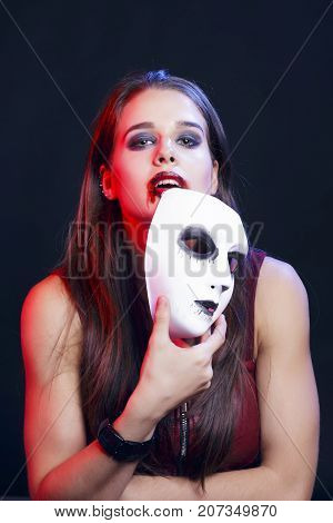 Brunette Woman Hiding Behind A White Venetian Mask.