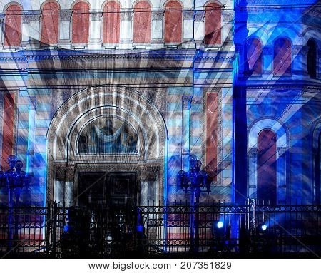 Intrigue with light.  Lodz, Poland - September 29, 2017Futuristic illumination with the light of the exterior facade of Alexander Nevsky's cervical light during the Light Art Festival in Lodz.