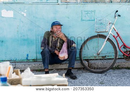 UKRAINE Genichesk - SEPTEMBER 19 2017: Homeless in the central market. The problem of homeless people living on the streets in cities.