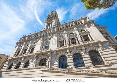 Prospective view of Porto City Hall or Camara Municipal do Porto in Avenida dos Aliados, Liberty square, Oporto in Portugal. Sunny day in the blue sky.