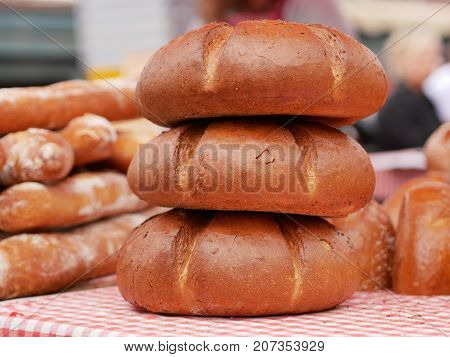 Traditional Czech Bread made of rye and wheat flours. Three round loafs of bread in a stack.