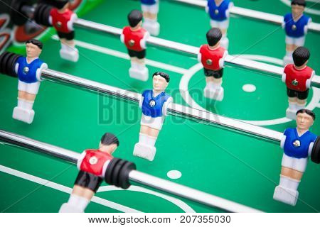 table football table football .sports teams players in red and blue uniform.