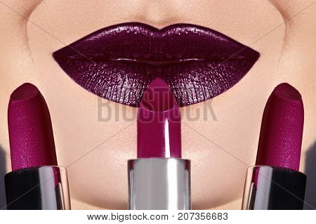 Trend Lips Makeup With Bright Dark Color Lipstick. Woman Applying Fashion Lip Make-up. Choice Lipsti