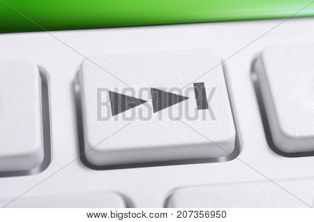 Macro Of A White Skip Forward Button Of A White Remote Control For A Hifi Stereo Audio System