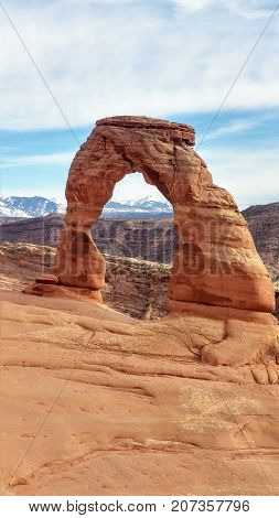 The Delicate Arch and surrounding desert landscape in Arches National Park.