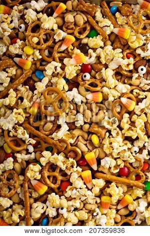 Homemade Halloween trail or snack mix with candycorn, popcorn, pretzels and nuts overhead shot