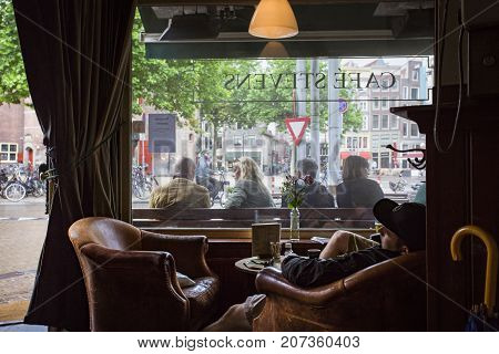 AMSTERDAM NETHERLANDS - JUNE 21 2016: Picture of the interior of a famous cooffe shop in Amsterdam named Cafe Stevens. Amsterdam Netherlands.