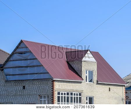 House Of Cinder Block. House With Plastic Windows And Roof Of Corrugated Sheet. Roofing Of Metal Pro